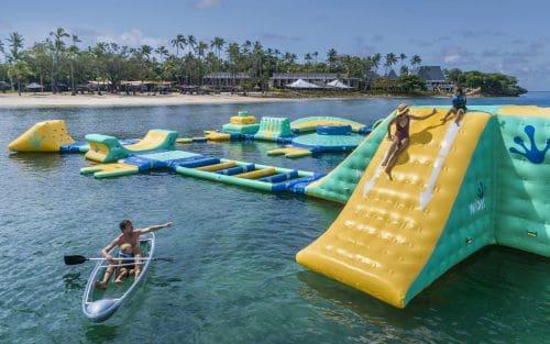 Shangri-la Fijian Resort & Spa Family fun on the inflatable waterpark off Lagoon Beach